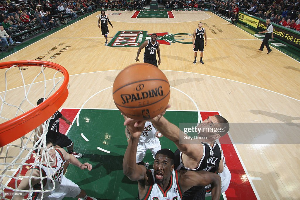 <a gi-track='captionPersonalityLinkClicked' href=/galleries/search?phrase=Ekpe+Udoh&family=editorial&specificpeople=4185351 ng-click='$event.stopPropagation()'>Ekpe Udoh</a> #13 of the Milwaukee Bucks shoots against <a gi-track='captionPersonalityLinkClicked' href=/galleries/search?phrase=Brook+Lopez&family=editorial&specificpeople=3847328 ng-click='$event.stopPropagation()'>Brook Lopez</a> #11 of the Brooklyn Nets on February 20, 2013 at the BMO Harris Bradley Center in Milwaukee, Wisconsin.