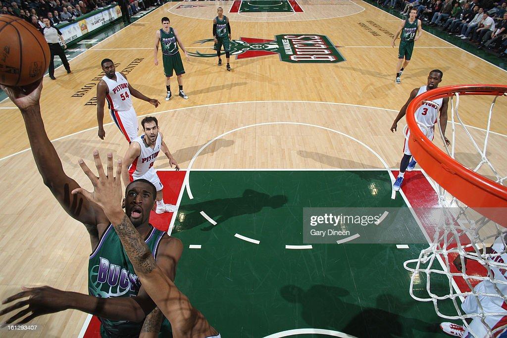 Ekpe udoh #13 of the Milwaukee Bucks shoots against Charlie Villanueva #31 of the Detroit Pistons on February 9, 2013 at the BMO Harris Bradley Center in Milwaukee, Wisconsin.
