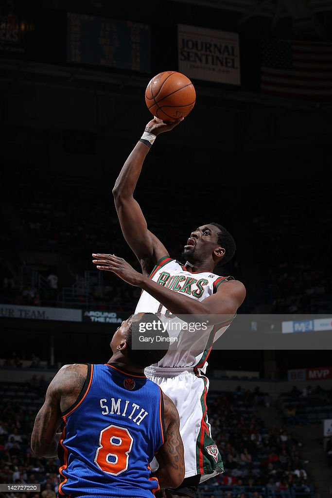 <a gi-track='captionPersonalityLinkClicked' href=/galleries/search?phrase=Ekpe+Udoh&family=editorial&specificpeople=4185351 ng-click='$event.stopPropagation()'>Ekpe Udoh</a> #13 of the Milwaukee Bucks shoots against <a gi-track='captionPersonalityLinkClicked' href=/galleries/search?phrase=J.R.+Smith&family=editorial&specificpeople=201766 ng-click='$event.stopPropagation()'>J.R. Smith</a> #8 of the New York Knicks on April 11, 2012 at the Bradley Center in Milwaukee, Wisconsin.