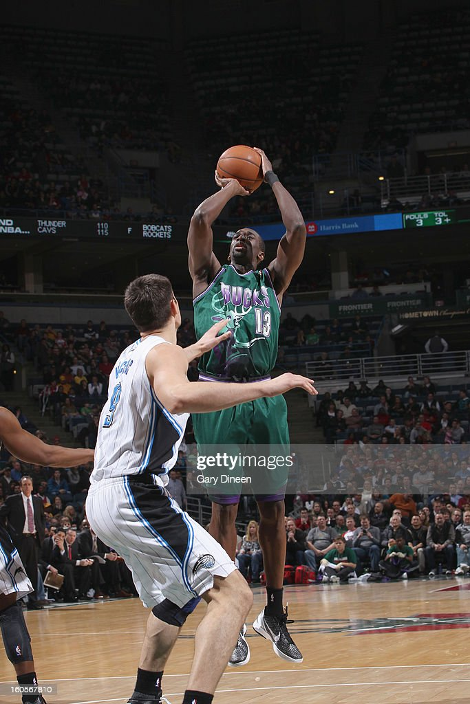 Ekpe Udoh #13 of the Milwaukee Bucks shoots against Nikola Vucevic #9 of the Orlando Magic on February 2, 2013 at the BMO Harris Bradley Center in Milwaukee, Wisconsin.
