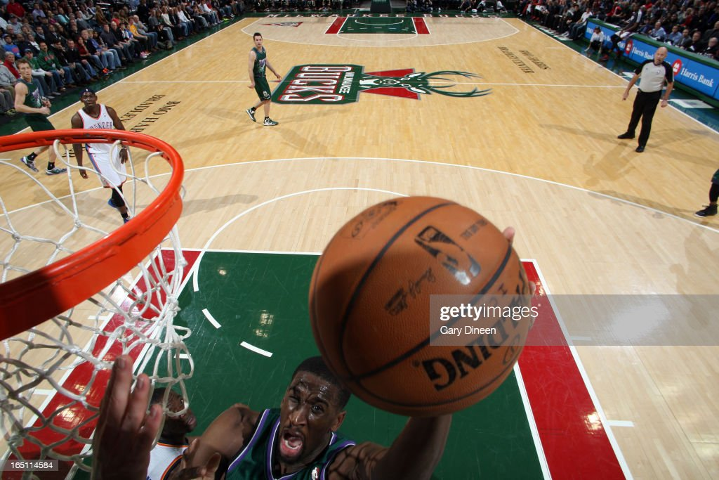 Ekpe Udoh #13 of the Milwaukee Bucks shoots against the Oklahoma City Thunder on March 30, 2013 at the BMO Harris Bradley Center in Milwaukee, Wisconsin.