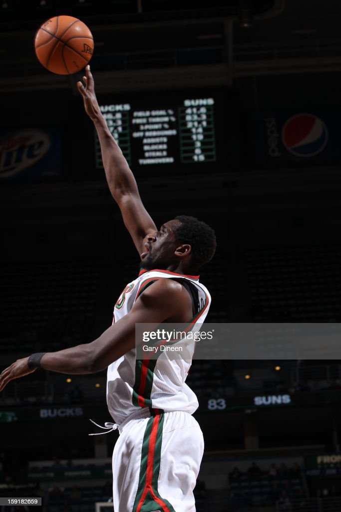 <a gi-track='captionPersonalityLinkClicked' href=/galleries/search?phrase=Ekpe+Udoh&family=editorial&specificpeople=4185351 ng-click='$event.stopPropagation()'>Ekpe Udoh</a> #13 of the Milwaukee Bucks shoots against the Phoenix Suns on January 8, 2013 at the BMO Harris Bradley Center in Milwaukee, Wisconsin.