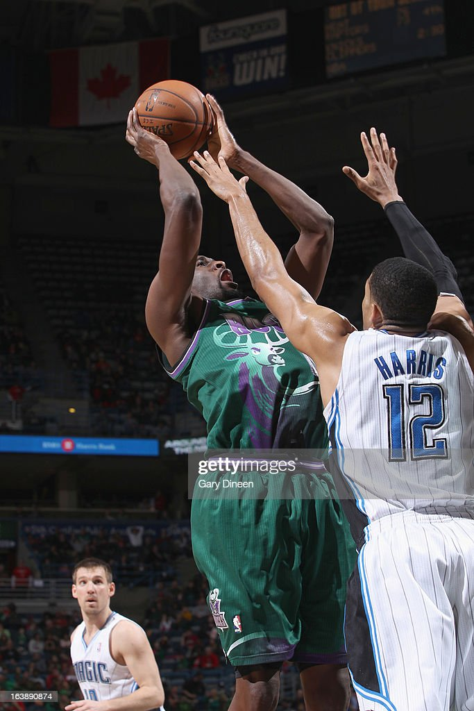 <a gi-track='captionPersonalityLinkClicked' href=/galleries/search?phrase=Ekpe+Udoh&family=editorial&specificpeople=4185351 ng-click='$event.stopPropagation()'>Ekpe Udoh</a> #13 of the Milwaukee Bucks shoots against <a gi-track='captionPersonalityLinkClicked' href=/galleries/search?phrase=Tobias+Harris&family=editorial&specificpeople=6902922 ng-click='$event.stopPropagation()'>Tobias Harris</a> #12 of the Orlando Magic on March 17, 2013 at the BMO Harris Bradley Center in Milwaukee, Wisconsin.