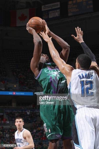 Ekpe Udoh of the Milwaukee Bucks shoots against Tobias Harris of the Orlando Magic on March 17 2013 at the BMO Harris Bradley Center in Milwaukee...