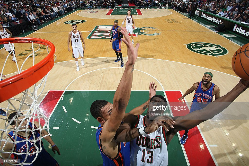 <a gi-track='captionPersonalityLinkClicked' href=/galleries/search?phrase=Ekpe+Udoh&family=editorial&specificpeople=4185351 ng-click='$event.stopPropagation()'>Ekpe Udoh</a> #13 of the Milwaukee Bucks shoots against <a gi-track='captionPersonalityLinkClicked' href=/galleries/search?phrase=Tyson+Chandler&family=editorial&specificpeople=202061 ng-click='$event.stopPropagation()'>Tyson Chandler</a> #6 of the New York Knicks on April 11, 2012 at the Bradley Center in Milwaukee, Wisconsin.