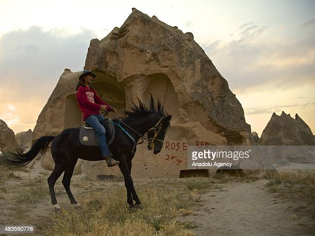 Ekrem Ilhan owner of a horseriding facility which organizes rides for tourists rides his horse near fairy chimneys in Cappadocia in Turkey's Nevsehir...
