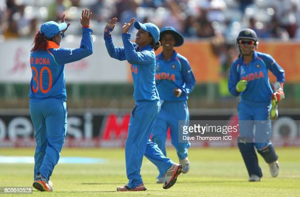 Ekta Bisht of India celebrates with Mona Meshram of India after bowling out Diana Baig of Pakistan during the ICC Women's World Cup match between...