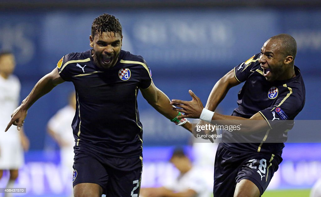 El Arabi Hilal Soudani (L) and <a gi-track='captionPersonalityLinkClicked' href=/galleries/search?phrase=Wilson+Eduardo&family=editorial&specificpeople=7150735 ng-click='$event.stopPropagation()'>Wilson Eduardo</a> of Dinamo Zagreb celebrate during the UEFA Europe League match between GNK Dinamo Zagreb and FC Astra Giurgiu at the Maksimir Stadium on September 18, 2014 in Zagreb,Croatia.