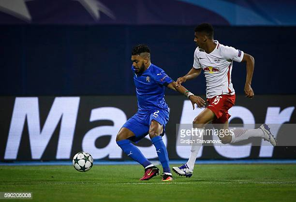 El Arabi Hilal Soudani of Dinamo Zagreb in action against Bernardo of Salzburg the UEFA Champions League Playoffs First leg match between Dinamo...