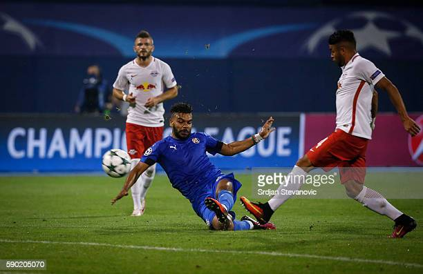 El Arabi Hilal Soudani of Dinamo Zagreb in action against Wanderson of Salzburg during the UEFA Champions League Playoffs First leg match between...