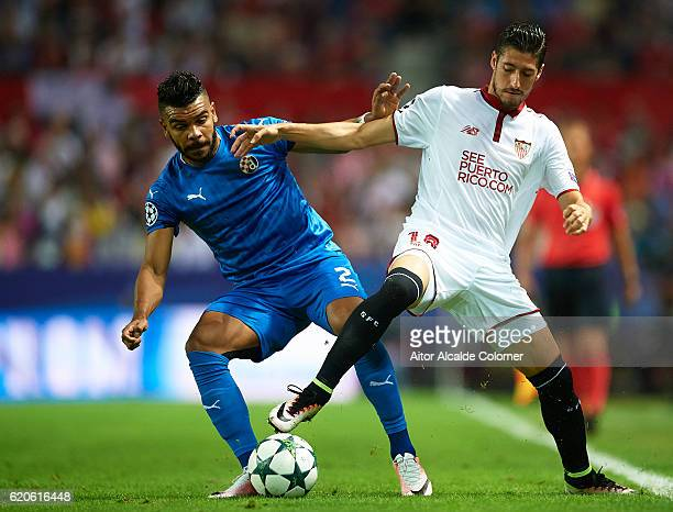 El Arabi Hilal Soudani of GNK Dimano Zagreb competes for the ball with Sergio Escudero of Sevilla FC during the UEFA Champions League match between...