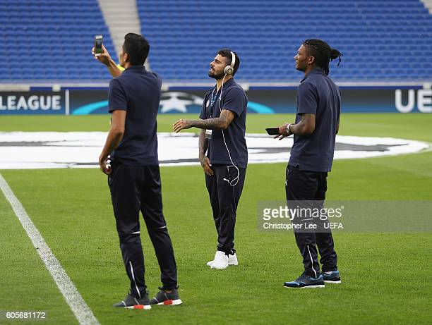 El Arabi Hilal Soudani of Zagreb dances and sings as he looks around at the stadium during the UEFA Champions League Group H match between Olympique...