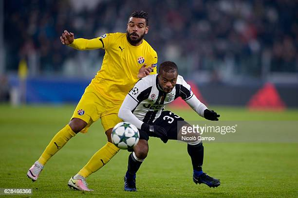 El Arabi Hillel Soudani of GNK Dinamo Zagreb and Patrice Evra of Juventus FC compete for the ball during the UEFA Champions League Group H football...