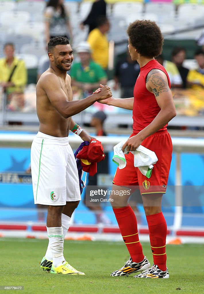 El Arabi Soudani of Algeria exchanges his jersey with <a gi-track='captionPersonalityLinkClicked' href=/galleries/search?phrase=Axel+Witsel&family=editorial&specificpeople=4345455 ng-click='$event.stopPropagation()'>Axel Witsel</a> of Belgium after the 2014 FIFA World Cup Brazil Group H match between Belgium and Algeria at Estadio Mineirao on June 17, 2014 in Belo Horizonte, Brazil.