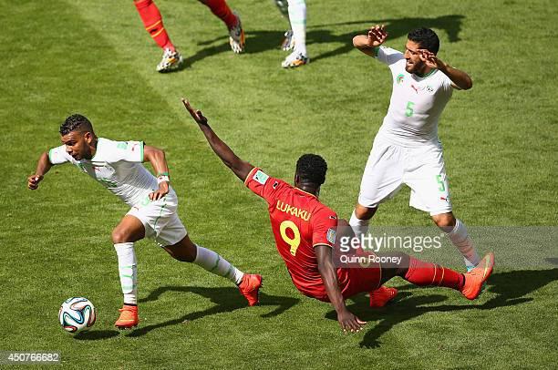 El Arbi Hillel Soudani of Algeria dribbles past Romelu Lukaku of Belgium during the 2014 FIFA World Cup Brazil Group H match between Belgium and...