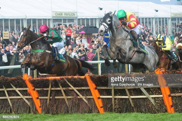 El Dancer ridden by Dominic Elsworth comes through the field to beat American Trilogy in the highstreetvoucherscom Top Novices' Hurdle during the...