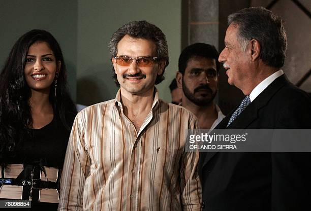 El Guatemalan president Oscar Berger talks with Saudi prince AlWaleed bin Talal 14 August 2007 at the Palace of Culture in Guatemala City Considered...
