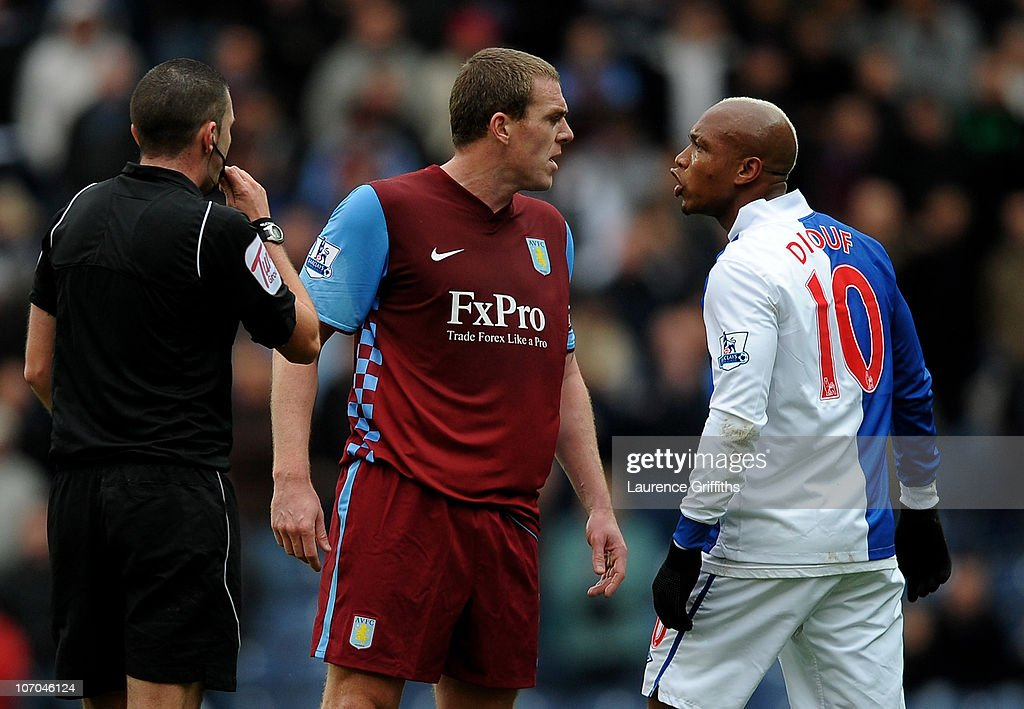 El Hadji Diouf of Blackburn Rovers and <a gi-track='captionPersonalityLinkClicked' href=/galleries/search?phrase=Richard+Dunne&family=editorial&specificpeople=209365 ng-click='$event.stopPropagation()'>Richard Dunne</a> of Aston Villa exchange views during the Barclays Premier League match between Blackburn Rovers and Aston Villa at Ewood Park on November 21, 2010 in Blackburn, England.