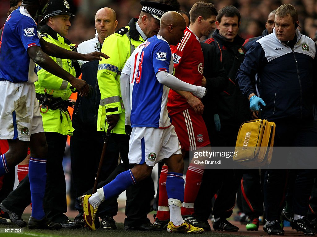 El Hadji Diouf of Blackburn Rovers and <a gi-track='captionPersonalityLinkClicked' href=/galleries/search?phrase=Steven+Gerrard&family=editorial&specificpeople=202052 ng-click='$event.stopPropagation()'>Steven Gerrard</a> of Liverpool leave the pitch at the end of the first half during the Barclays Premier League match between Liverpool and Blackburn Rovers at Anfield on February 28, 2010 in Liverpool, England.
