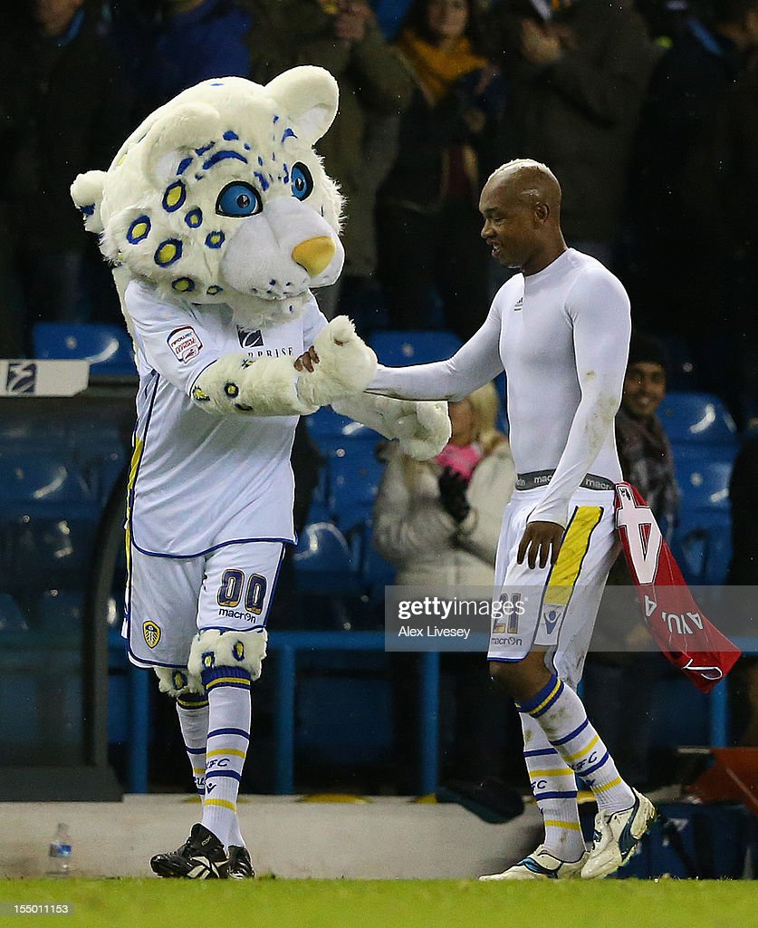 El Hadji Diouf of Leeds United is congratulated by team mascot Lucas the Kop Cat at the end of the Capital One Cup Fourth Round match between Leeds United and Southampton at Elland Road on October 30, 2012 in Leeds, England.