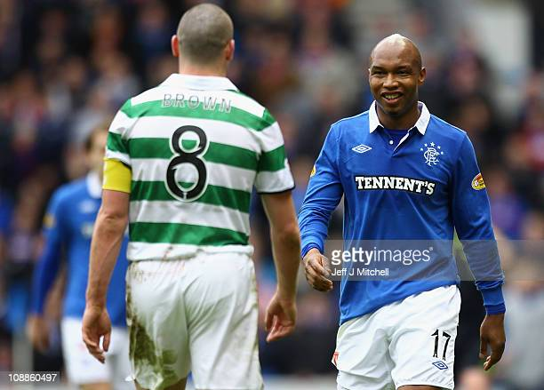 El Hadji Diouf of Rangers and Scott Brown of Celtic react during the Scottish Cup 5th round match between Rangers and Celtic at Ibrox Stadium on...