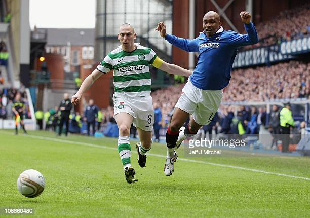 El Hadji Diouf of Rangers tackles Scott Brown of Celtic during the Scottish Cup 5th round match between Rangers and Celtic at Ibrox Stadium on...