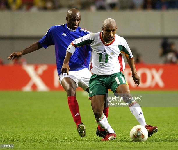El Hadji Diouf of Senegal shields the ball from Patrick Vieira of France during the France v Senegal Group A World Cup Group Stage match played at...