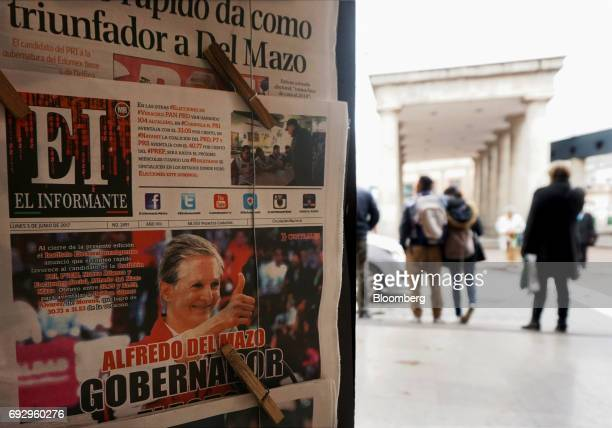 El Informante newspaper featuring the image of Alfredo del Mazo Institutional Revolutionary Party candidate for governor of the State of Mexico hangs...