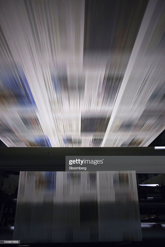 El Pais newspaper pages run through the printing presses at the El Pais printing plant in Madrid, Spain, on Tuesday, Oct. 30, 2012. Prisa, the publisher of El Pais newspaper, has announced staff reductions and salary cuts. Photographer: Angel Navarrete/Bloomberg via Getty Images