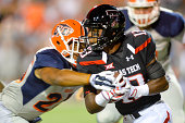 DeAndre Washington of the Texas Tech Red Raiders breaks the tackle of Dashone Smith of the UTEP Miners during game action on September 6 2014 at the...