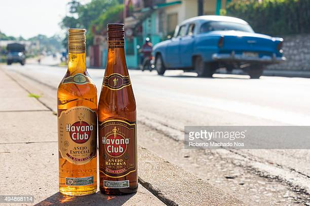 El Ron de Cuba Bottles of Havana Club rum on the pavement with vehicles moving in the background Havana Club brand of rum created in 1934 is one of...