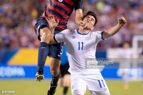 El Salvador Forward Rodolfo Zelaya takes an elbow to the face from United States Defender Omar González in the first half during the CONCACAF Gold...