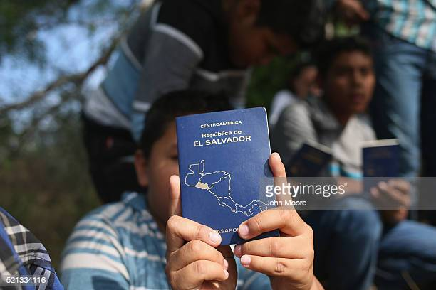 El Salvadorian immigrant children sit while talking with Border Patrol agents after the Central American families crossed the Rio Grande from Mexico...