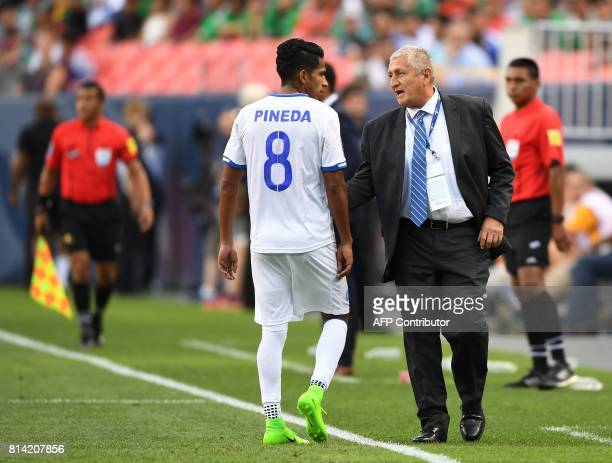 El Salvador's Denis Pineda talks with coach Eduardo Lara in their Group C game against Curazao during the 2017 CONCACAF Gold Cup at the Sports...