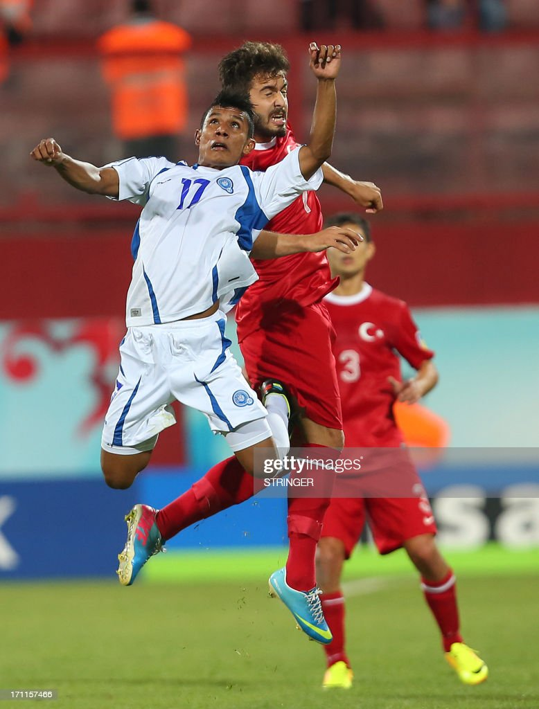 El Salvador's Kevin Mendoza (L) jumps for the ball during the group stage football match between Turkey and El Salvador at the FIFA Under 20 World Cup at the Avni Aker stadium in Trabzon on June 22, 2013.