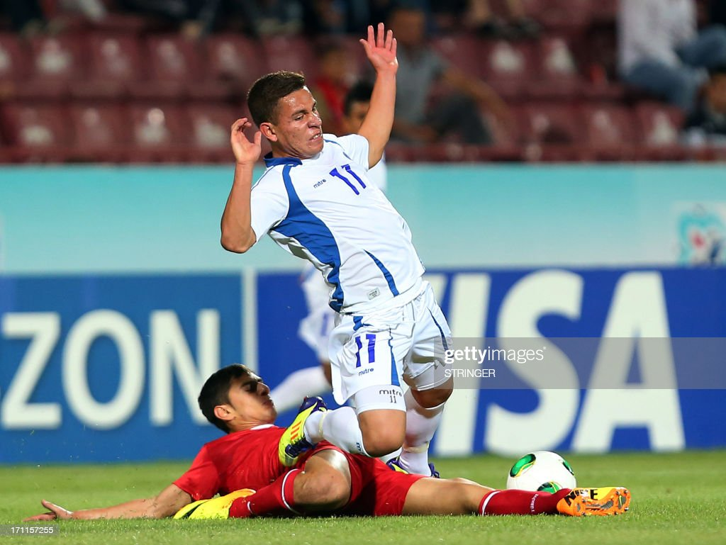 El Salvador's Maikon Orellana (R) falls during the group stage football match between Turkey and El Salvador at the FIFA Under 20 World Cup at the Avni Aker stadium in Trabzon on June 22, 2013.