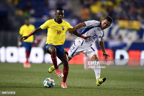 El Salvador's midfeilder Narcisco Orellana vies for the ball with Ecuador's midfielder Juan Cazares during their international friendly match at the...