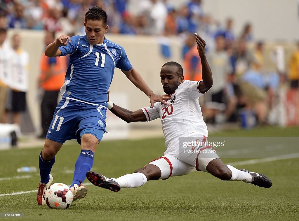 El Salvador's Rodolfo Zelaya is challenged by Trinidad Tobago's Seon Power during their CONCACAF Gold Cup match on July 8 2013 at the Red Bull Arena...