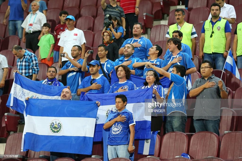 El Salvador's supporters put their hand on their heart during the group stage football match between Turkey and El Salvador at the FIFA Under 20 World Cup at the Avni Aker stadium in Trabzon on June 22, 2013.