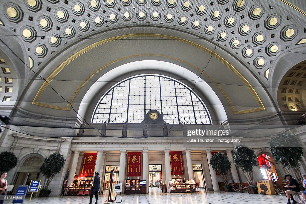 Elaborate Gold Leaf High Ceiling Hand Painted Walls an Arched Window in the Interior Of Union Station Located in Washington DC Part of the US...