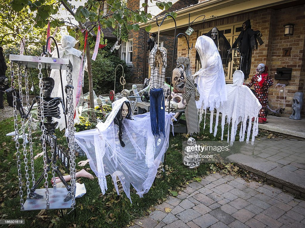 elaborate halloween decorations on the front lawn of a house in the beaches toronto