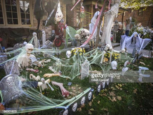Elaborate Halloween decorations on the front lawn of a house in the Beaches Toronto October 29