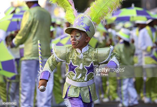 Elaborately dressed minstrels parade down the street in a jubilant fashion on January 02 2016 in Cape Town South Africa The parade which dates back...