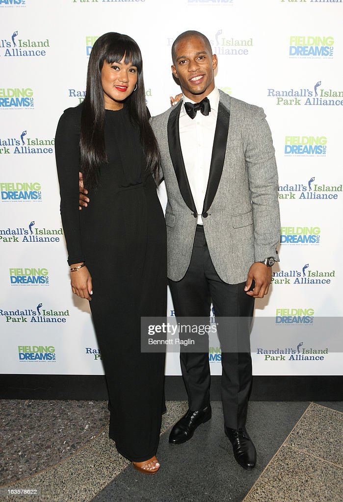 Elaina Watley and Victor Cruz attend the Randall's Island Park Alliance Fielding Dreams 2013 Gala at American Museum of Natural History on March 12, 2013 in New York City.