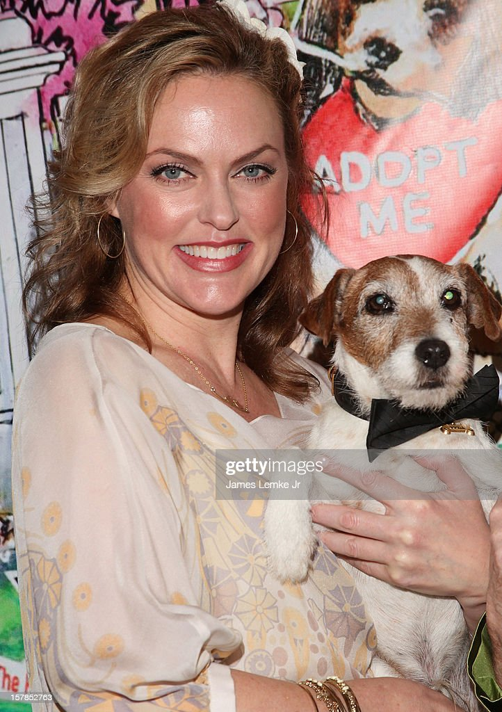 Elaine Hendrix and Uggie attend the Follow The Stars/Adopt A Pet 2013 Rose Parade Float Unveiling held at the Beverly Hills City Hall on December 6, 2012 in Beverly Hills, California.