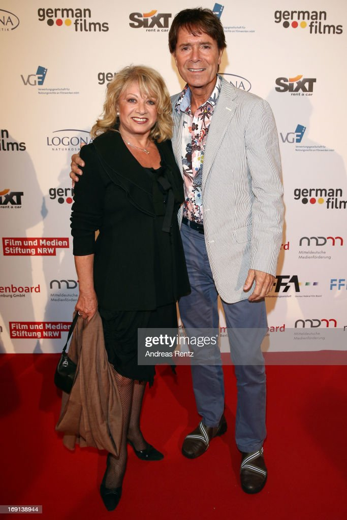 <a gi-track='captionPersonalityLinkClicked' href=/galleries/search?phrase=Elaine+Paige&family=editorial&specificpeople=207114 ng-click='$event.stopPropagation()'>Elaine Paige</a> and <a gi-track='captionPersonalityLinkClicked' href=/galleries/search?phrase=Cliff+Richard&family=editorial&specificpeople=158267 ng-click='$event.stopPropagation()'>Cliff Richard</a> attend the German Films reception during the 66th Annual Cannes Film Festival at the Majestic Beach on May 20, 2013 in Cannes, France.