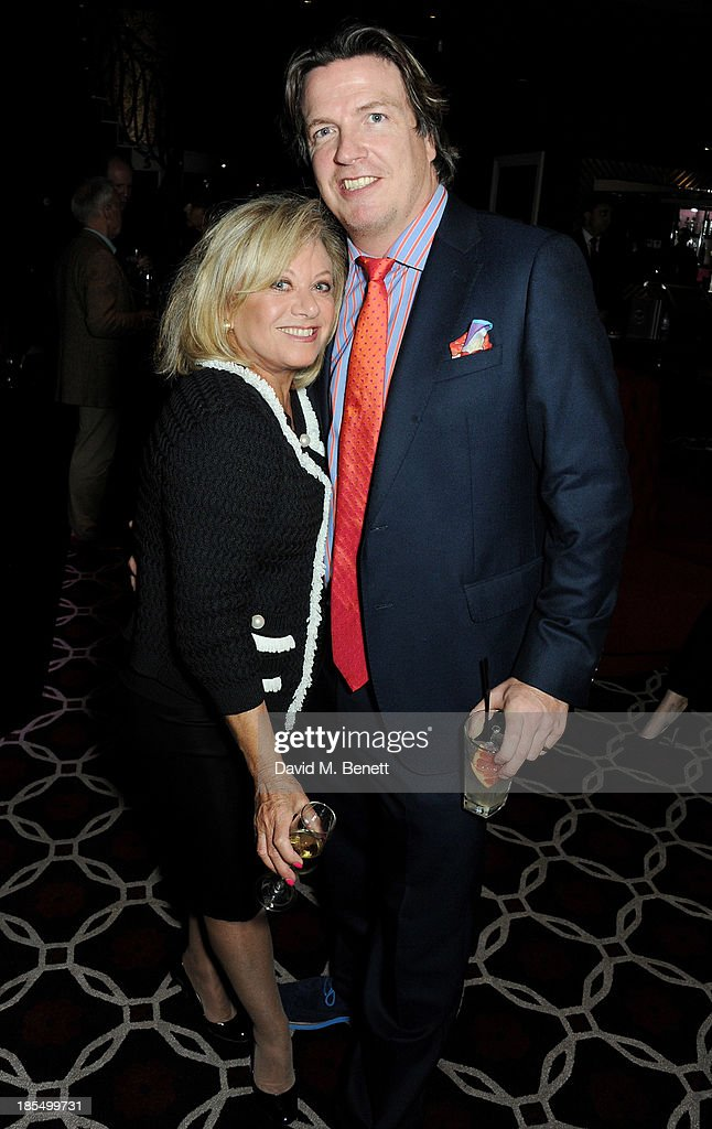 Elaine Paige (L) and Justin Mallinson attend the launch of Joan Collins new book 'Passion For Life' at No.41 Mayfair Club at The Westbury Hotel on October 21, 2013 in London, England.