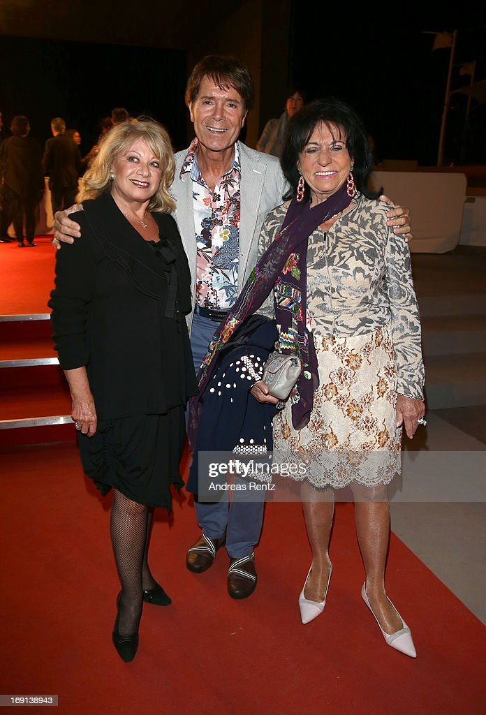 <a gi-track='captionPersonalityLinkClicked' href=/galleries/search?phrase=Elaine+Paige&family=editorial&specificpeople=207114 ng-click='$event.stopPropagation()'>Elaine Paige</a>, <a gi-track='captionPersonalityLinkClicked' href=/galleries/search?phrase=Cliff+Richard&family=editorial&specificpeople=158267 ng-click='$event.stopPropagation()'>Cliff Richard</a> and Regine Sixt attend the German Films reception during the 66th Annual Cannes Film Festival at the Majestic Beach on May 20, 2013 in Cannes, France.
