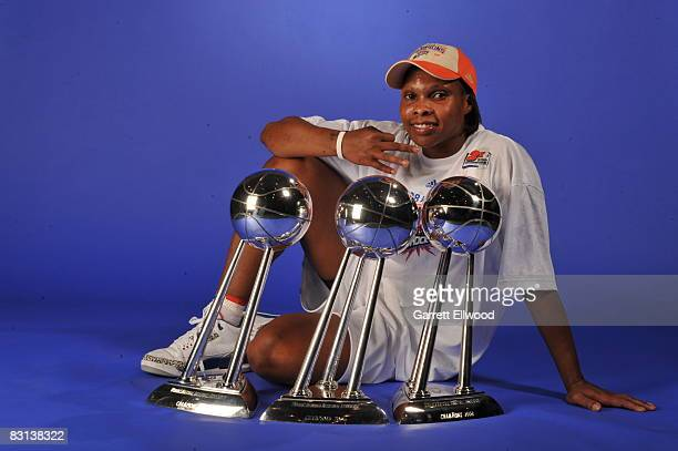 Elaine Powell of the Detroit Shock poses for a portrait with the trophy after winning Game Three of the WNBA Finals against the San Antonio Silver...