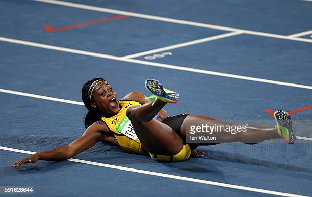 Elaine Thompson of Jamaica celebrates after winning the gold medal in the Women's 200m Final on Day 12 of the Rio 2016 Olympic Games at the Olympic...
